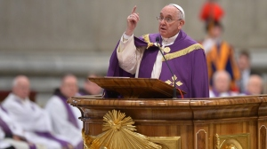 Pope Francis speaks at St. Peter's Basilica on Friday. On the second anniversary of his election, Francis said his pontificate will be short, perhaps less than five years.