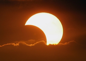 The moon casts a shadow at the sun blocking it partially in a partial solar eclipse as it sets on Monday Jan. 26, 2009 at Manila's bay, Philippines. (AP Photo/Aaron Favila)